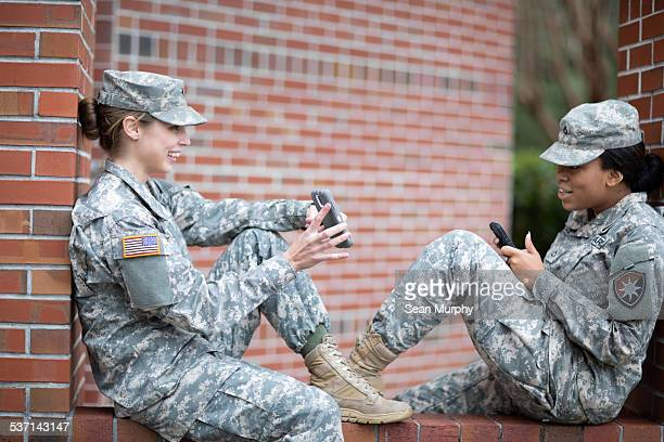 Female Soldiers Using Cell Phones