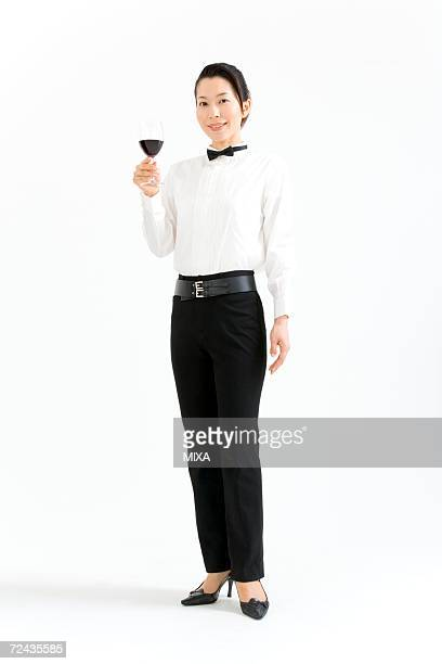 A female sommelier holding a glass of wine