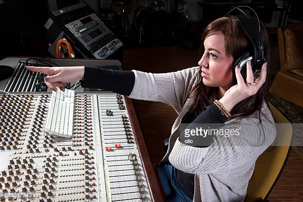 female sound engineer at studio mixing desk - producer stock pictures, royalty-free photos & images