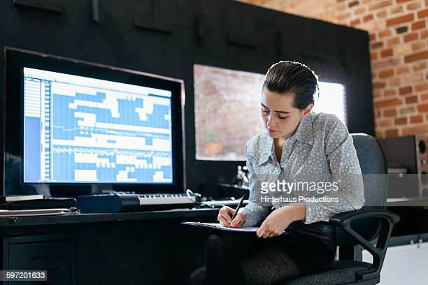 Female sound engineer in a record studio