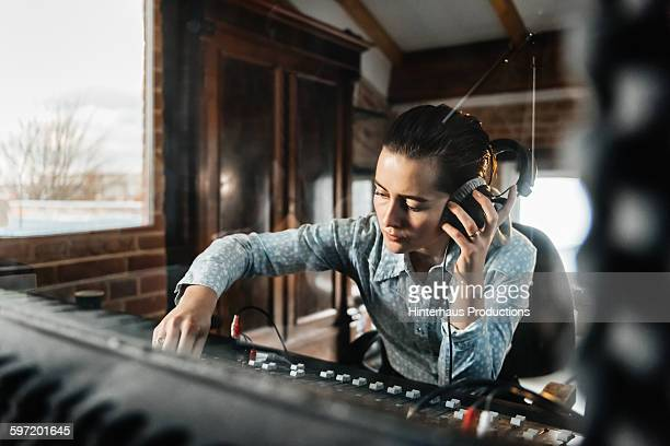 female sound engineer in a recording studio - sound recording equipment stock pictures, royalty-free photos & images
