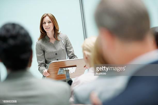 Female speaker in business seminar
