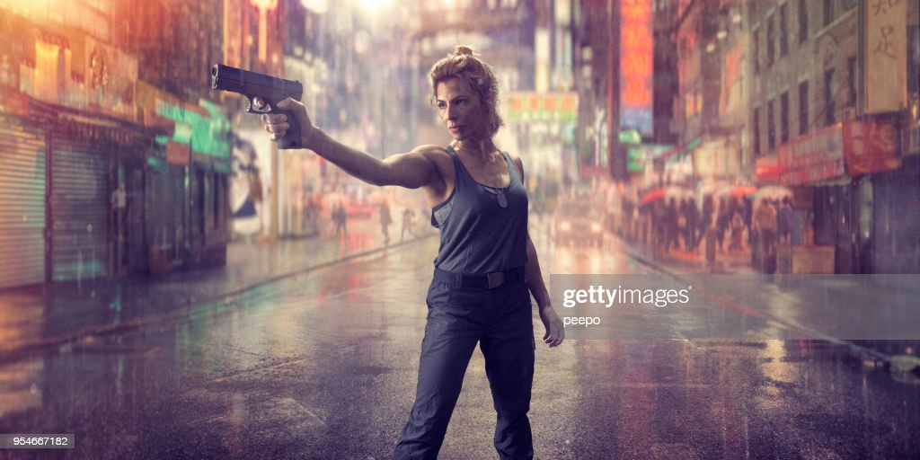 Female Special Forces Action Hero Soldier With Gun in Chinatown : Stock Photo
