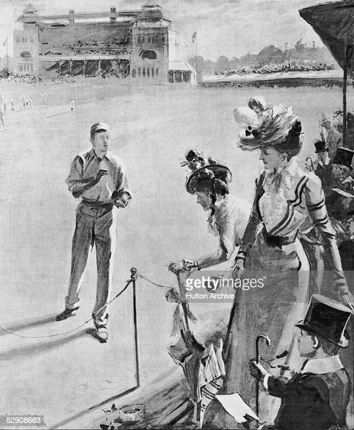 A female spectator retrieves the ball after a boundary shot during a cricket match between the two public schools Eton and Harrow 22nd July 1899 The...