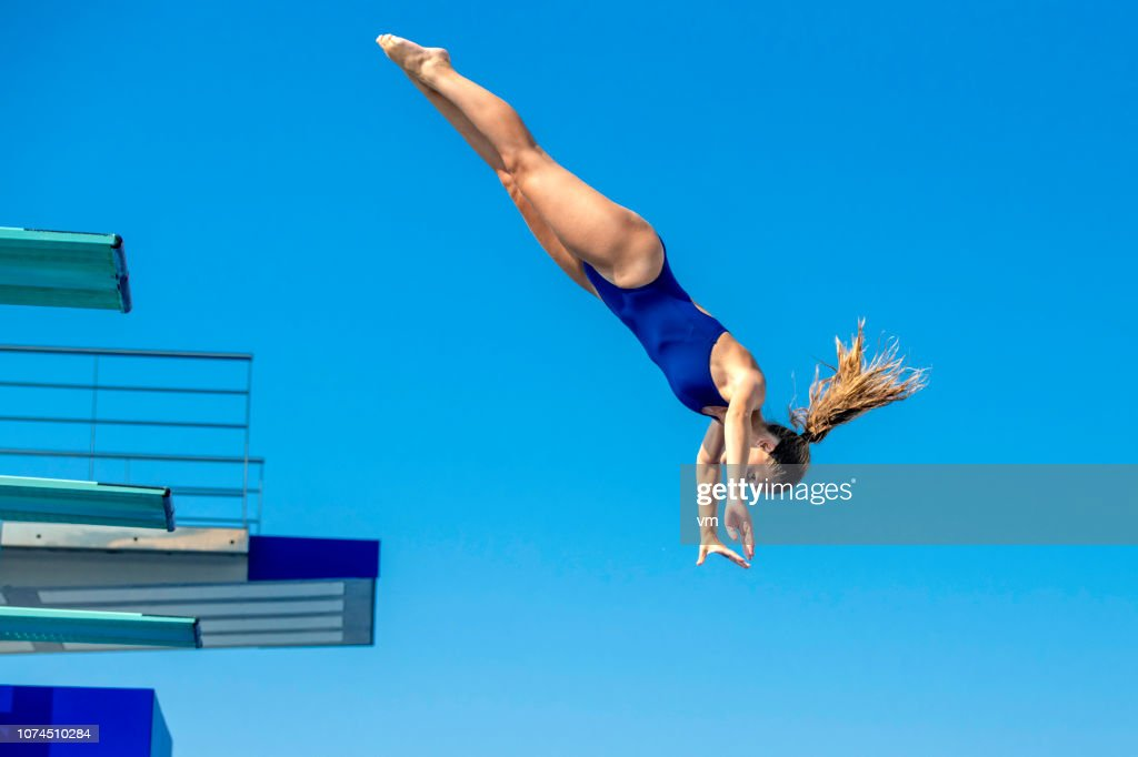 Female springboard diver jump : Stock Photo