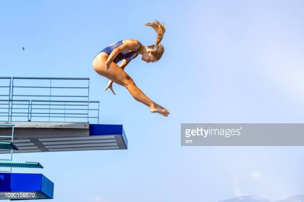 female springboard diver jump - high up stock pictures, royalty-free photos & images