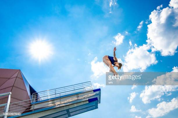 female springboard diver - diving platform stock pictures, royalty-free photos & images