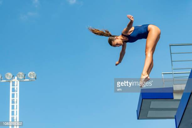female springboard diver - pike position stock photos and pictures