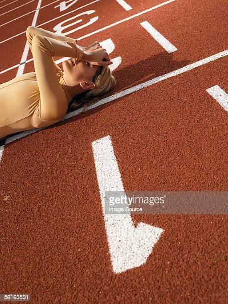 Female sprinter on finish line