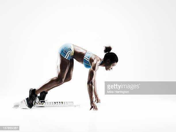 Female Sprinter On Starting Blocks