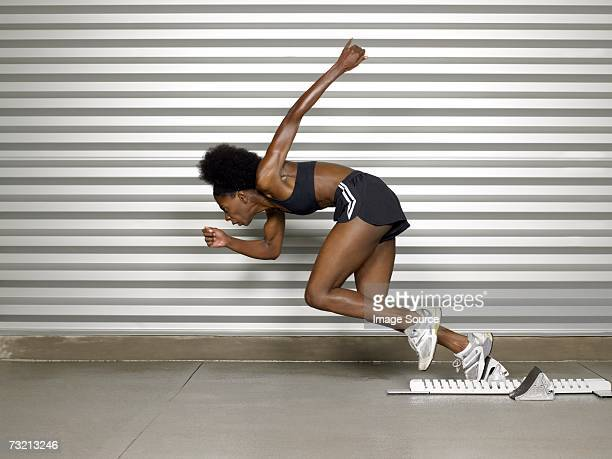 female sprinter - fast shutter speed stock photos and pictures