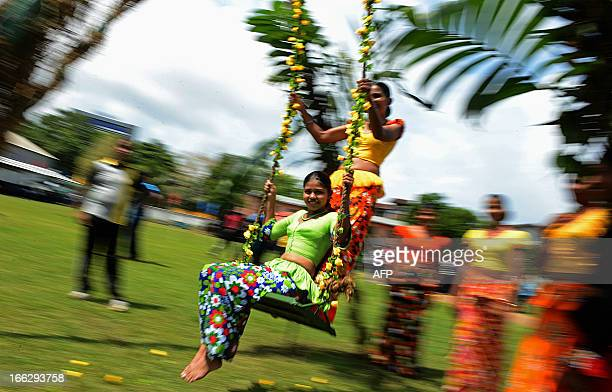 Female Sri Lankan soldiers participate in celebrations marking Sinhala and Tamil New Year celebrations in Colombo on April 11 2013 The New Year dawns...