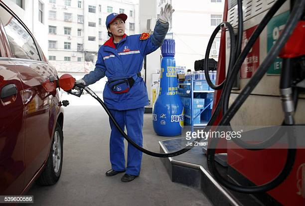 A female staff works at a gas station in Huaibei Anhui province China on 27th March 2015PetroChina the nation's largest oil and gas producer posted a...