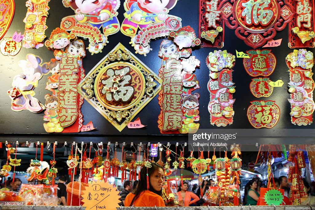 A female stall holder is seen waiting for customers in Chinatown on February 4, 2013 in Singapore. On February 10th, Chinese around the world will welcome the Year of the Snake, one of the most anticipated holidays of the Chinese calendar. Also known as the Spring festival or the Lunar New Year, the celebrations last for about 15 days.