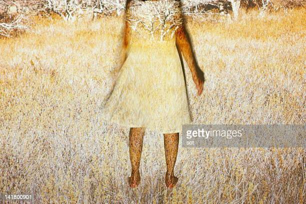 Female standing in grassy plain