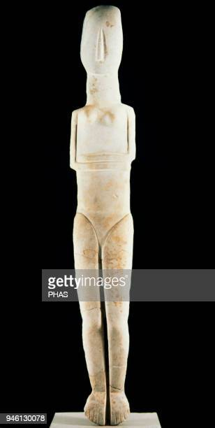 Female statue of the Early Cycladic foldedarm type Parian marble 27002300 BC National Archaeological Museum of Athens Greece
