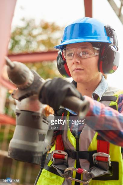 female steel worker with drill