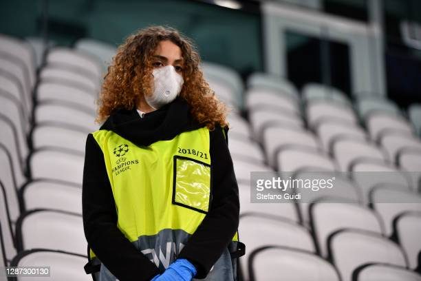 Female steward with UEFA Champions logo during of training session ahead of the UEFA Champions League Group G stage match between Ferencvaros...
