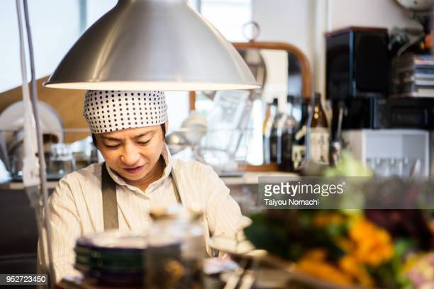 Female store manager preparing for opening in the kitchen