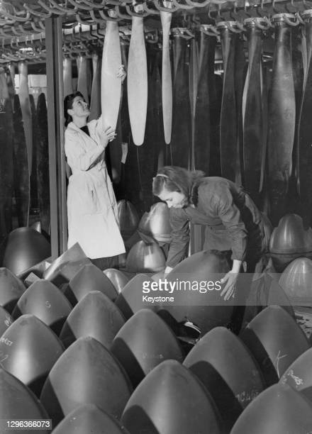 Female storeroom workers arrange aeroplane variable-pitch propeller blade and spinner component parts for future assembly at a Ministry of Aircraft...
