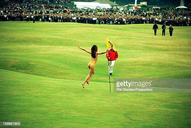A female streaker grabs the pin at the British Open Golf Championship held at St Andrews Scotland circa July 2000