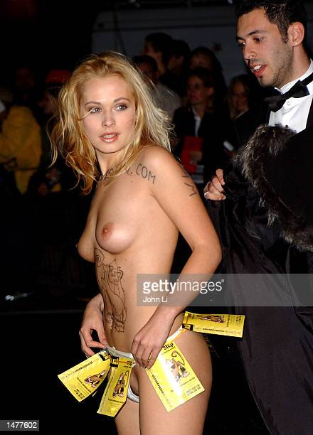 A female streaker manages to gain access to the celebrity arrival area for the National Television Awards held at the Royal Albert Hall Kensington...