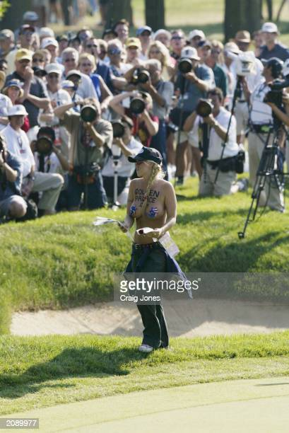 A female streaks out onto the 11th hole during the final round of the 2003 US Open on the North Course at the Olympia Fields Country Club on June 15...