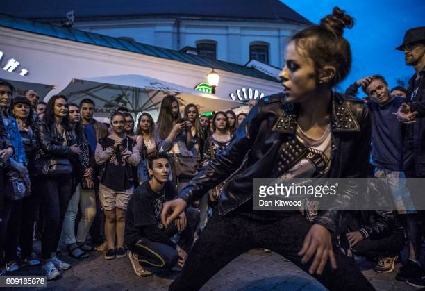 A female street dancer draws a crowd on July 01 2017 in Minsk Belarus Independence Day also known as the Day of the Republic is celebrated annually...