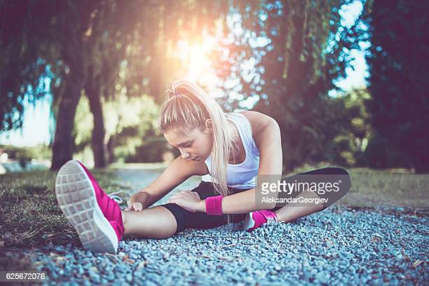 Female Stretching Before Jogging in the Nature at Sunset