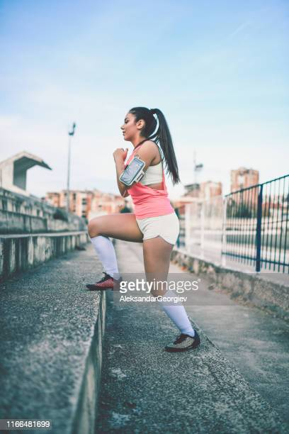 female stretching for training - extra long stock pictures, royalty-free photos & images