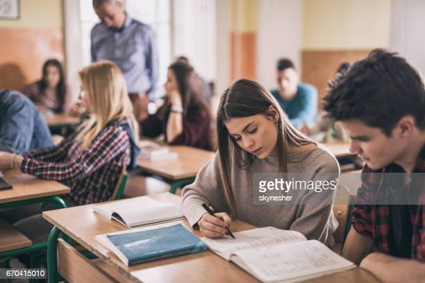female student and her classmate learning together in the classroom. - student stock photos and pictures