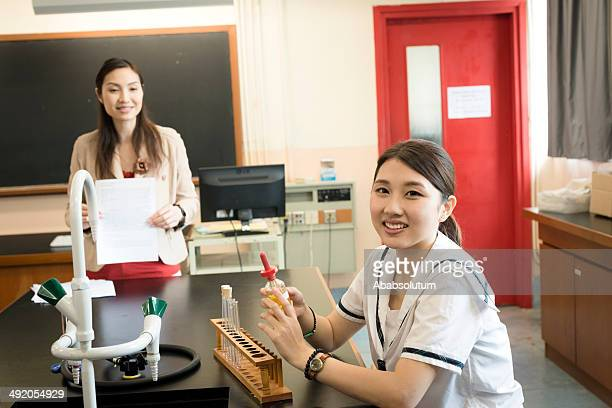 Female Student and Teacher in Chemistry Lab, Hong Kong