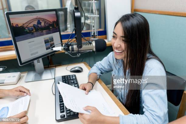 female student broadcasting from the university's radio station - journalist stock pictures, royalty-free photos & images