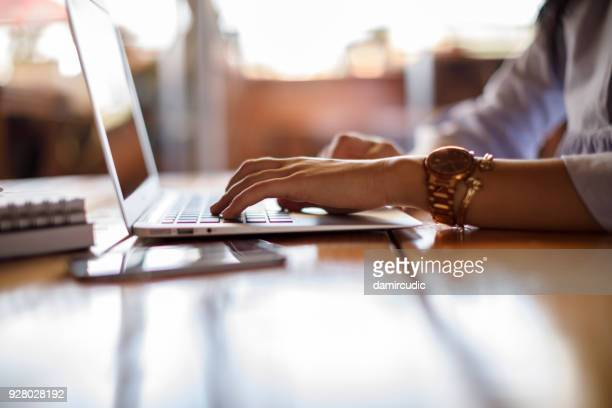 female student checking her computer - computer keyboard stock pictures, royalty-free photos & images