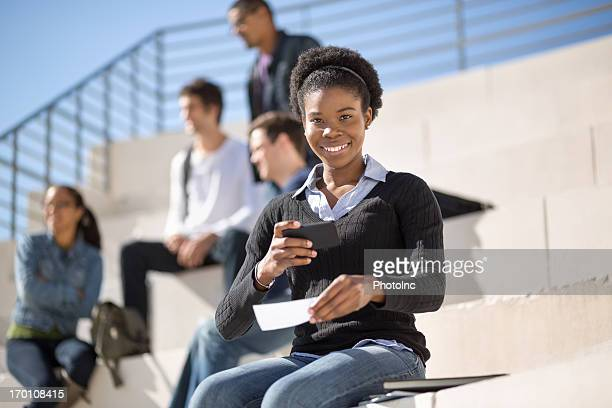 Female Student Depositing Check Through Phone