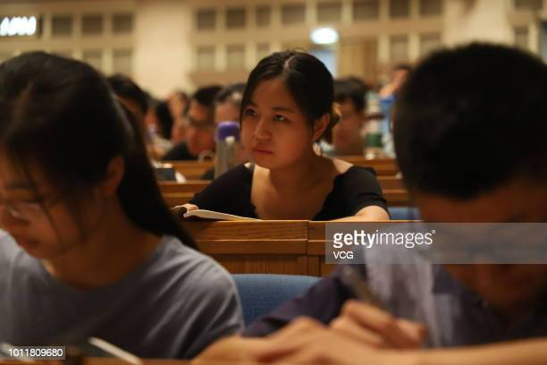 Female student has classes for the Postgraduate Admission Test at an assembly hall on August 1, 2018 in Jinan, Shandong Province of China. Over 3,000...