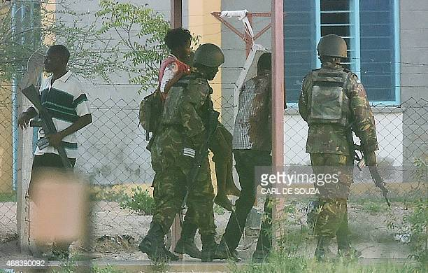 Female student hostage is escorted out of Garissa University after Kenya Defence Forces ended a siege by terrorist gunmen on April 2, 2015. At least...