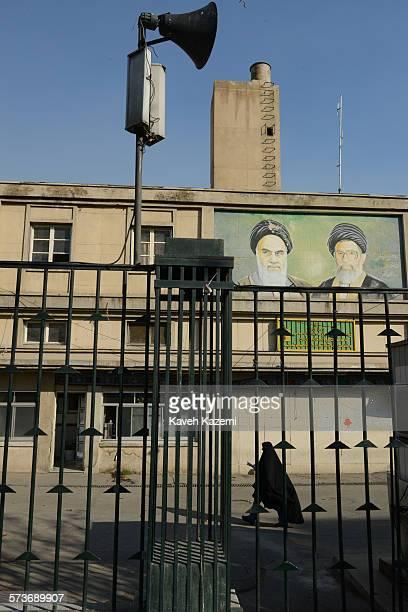Female student in black chador passes by the building of Basij Mobilisation Resistance Force at Tehran university where Ayatollah Ruhollah Khomeini...