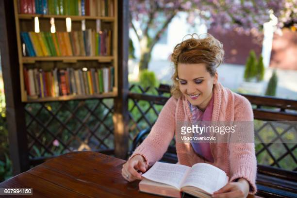 Female student in city garden library