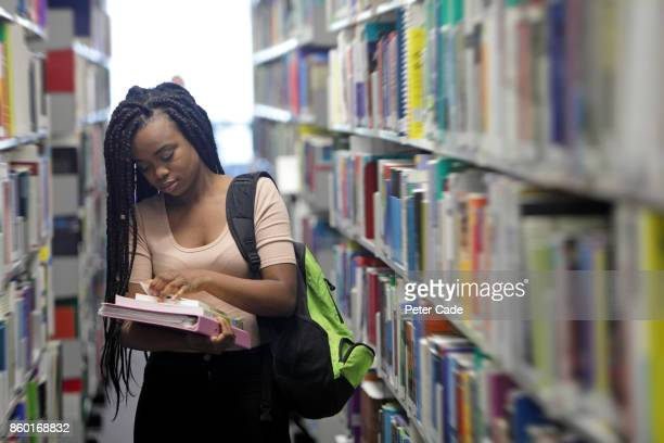 female student in library - library stock pictures, royalty-free photos & images