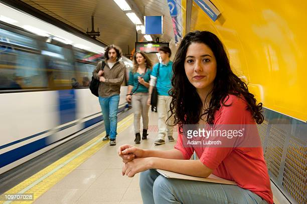 Female student in subway statiion