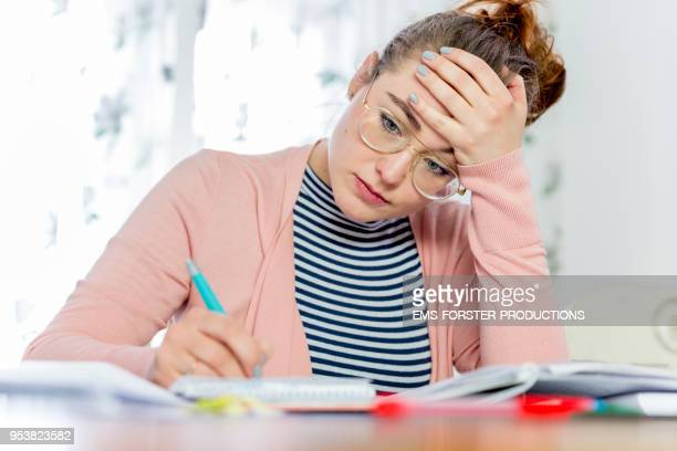 female student learning and working at home. - extra long stock pictures, royalty-free photos & images