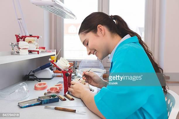 Female student learning prosthetic dentistry