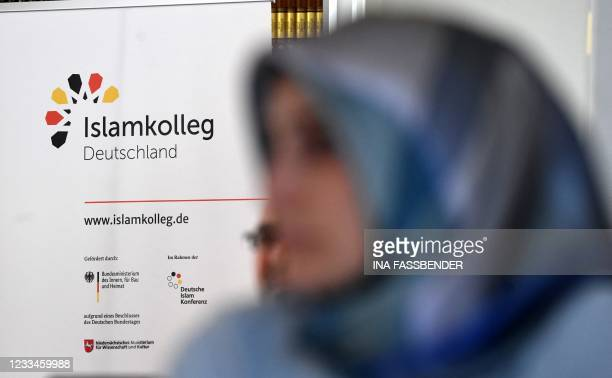 Female student listens during a lesson in the classroom of the Islamkolleg Deutschland in Osnabrueck, western Germany on June 14, 2021. - The first...