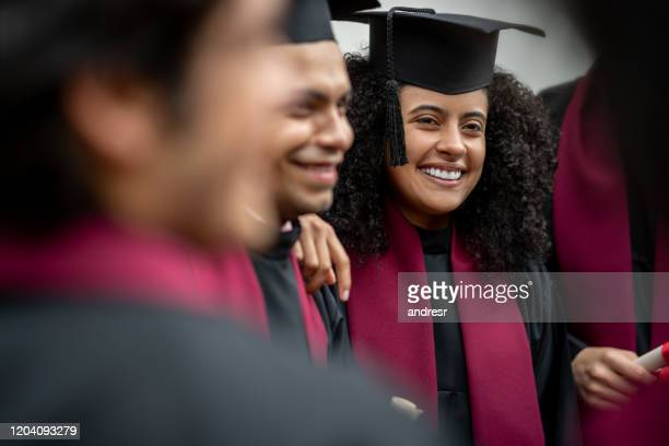 female student looking happy on her graduation day - alumni stock pictures, royalty-free photos & images