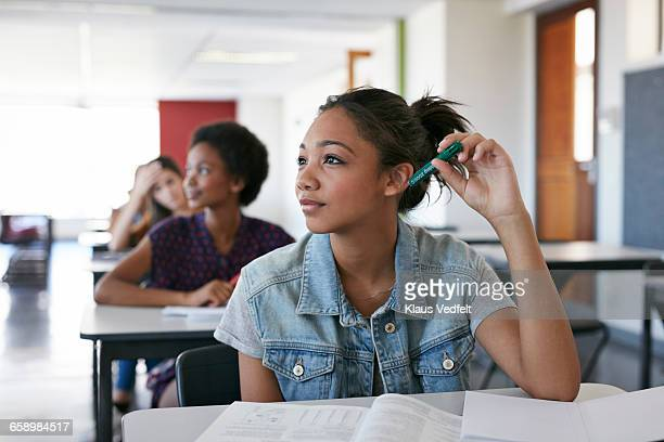 Female student looking out in classroom