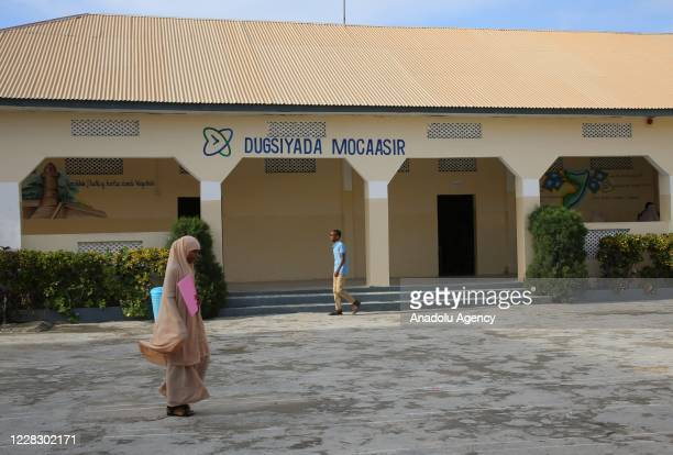 A female student moves to her classrooms as schools begin in the Somalian capital Mogadishu on September 01 2020 under the measures taken against the...