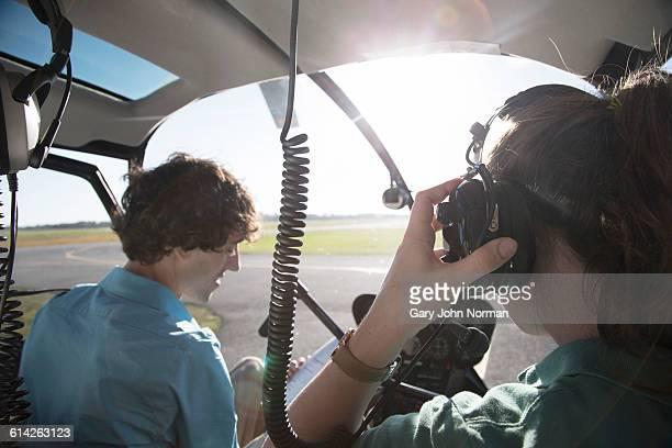 female student pilot in helicopter cockpit. - inside helicopter imagens e fotografias de stock