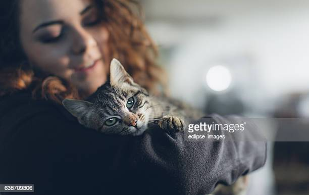 Female student playing with cat