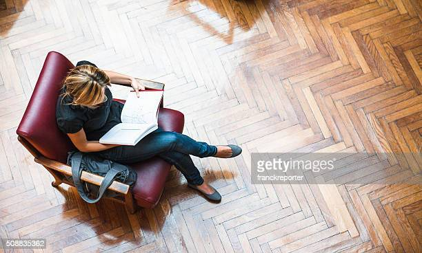 female student reading a book library - book store stock photos and pictures